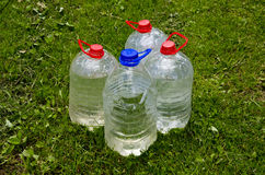 Four plastic water bottle on  grass Stock Photo