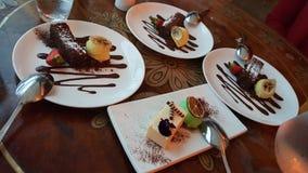 Four plates = four deserts. Stock Photos