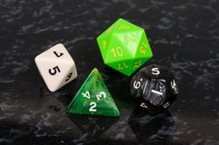 Four platonic dice. Stock Photo