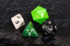 Four platonic dice. Stock Photo