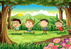 Four playful kids at the forest Royalty Free Stock Photos