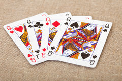 Four playing cards - queens on canvas Stock Photography