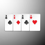 Four playing cards suits symbols on gray background Stock Photography