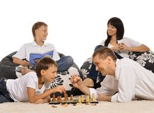 Four playing chess Stock Photos