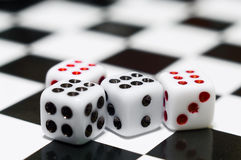 Four playing dices Stock Images