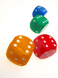 Four Playing Roll The Dice Stock Photo