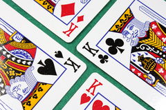 Four poker cards. On a green background Royalty Free Stock Photography