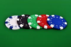 Four poker chips Stock Photo
