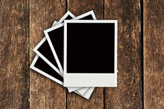 Four Polaroid old wood background Royalty Free Stock Images