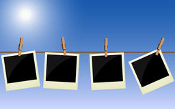 Four polaroid pictures hanging on rope Royalty Free Stock Photo