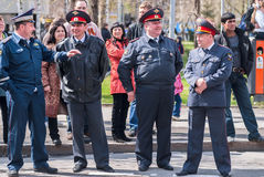 Four policemen stand in cordon Stock Photography