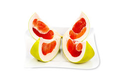 Four Pomelo Fruit Slices on a Plate Stock Photo