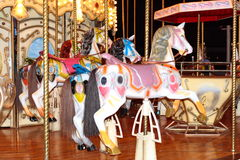 Four pony carosel. Row of four pony's of a carousel Stock Image