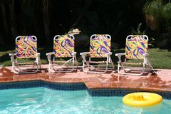 Four Pool Chairs Stock Photography