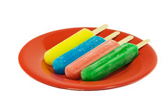 Four popsicles on a red plate Royalty Free Stock Images