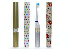 Four colorful electric toothbrush for family isolated on white background royalty free stock image