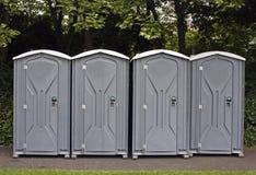 four portable toilets  Royalty Free Stock Photo