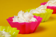 Four portions of whipped cream Stock Photos