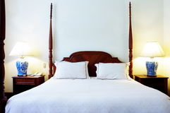 Four post bed. Four post wooden bed and bedside tables Royalty Free Stock Photos