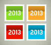 Four postage stamps New year 2013. Four postage stamps, green, orange, red and blue stamps Stock Images