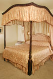 Four Poster Bed. Luxury Four Poster Bed in mansion Hotel Royalty Free Stock Photo