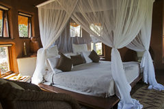 Four-poster bed in an African lodge Royalty Free Stock Images