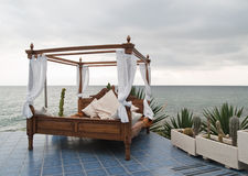Four poster bed by the sea Stock Photography