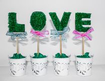 Four pots, in them sticks with a word - Love. stock photos
