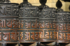 Four Prayer wheels Stock Photo
