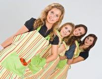 Four pretty cooks Royalty Free Stock Photos