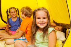 Four pretty little kids sit in a tent Stock Photos