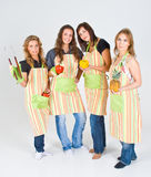 Four pretty teenage cooks Stock Photo