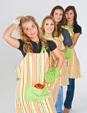 Four pretty teenage cooks Stock Photography