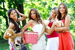 Four pretty young caucasian women in the park Royalty Free Stock Photography