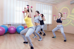 Four Professional Sportswomen Having Trunk Bending Exercises wit Royalty Free Stock Photo