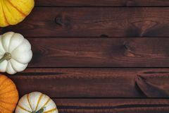 Four pumpkins on a brown background. royalty free stock photo