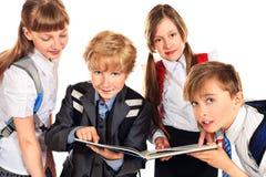 Four pupils Stock Image