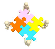 Four puppets, holding in hands a puzzle Royalty Free Stock Photo