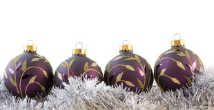 Four purple baubles Stock Photos