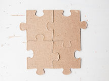 Four puzzle pieces Stock Photography