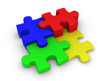 Four puzzle pieces connected. Four different colored 3d puzzle pieces are connected Stock Photo