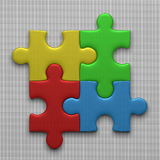 Four puzzle pieces. Four connected multicolor glossy puzzle pieces lying on gray squared background Stock Photo