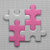 Four puzzle pieces. Connected white puzzle pieces and pink ones lying on gray background Royalty Free Stock Photo