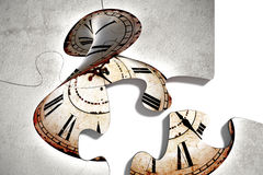 Four puzzle pieces with twisted clock Royalty Free Stock Photos