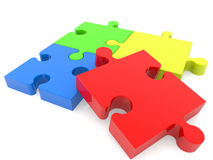 Four puzzle pieces in various colors Royalty Free Stock Photography