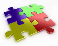 Four puzzle pieces of various colors, red, blue, y Stock Photo