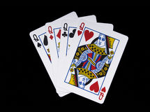 Four Queens. Poker hand shot on black Stock Images