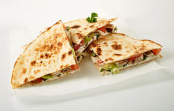 Four quesadilla parts on wax paper Royalty Free Stock Photography