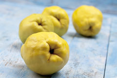Image result for Quince on blue wooden table