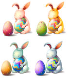 Four rabbits with easter eggs Royalty Free Stock Images